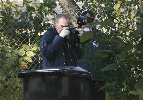 Image: Police photographer at crime scene