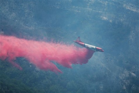 Image: Air tanker dumps retardant on fire