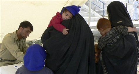 Image: Pakistani tribal women and their children visit a doctor