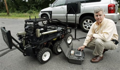 Image: Black-I Robotics founder Brian Hart and bomb-defusing robot.