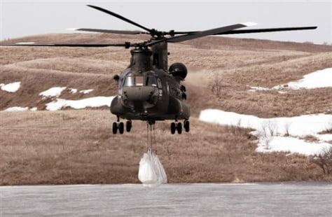 Image: Helicopter lifts sandbags