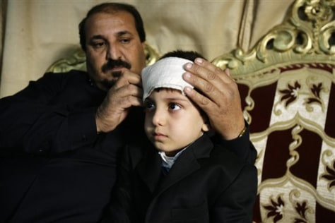 Image: Sami Hawas, a 42-year-old taxi driver, and his 7-year-old son Mohammed, at home in Baghdad