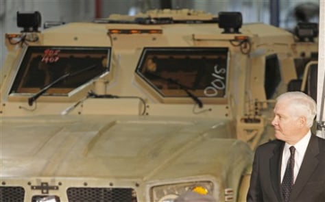 Image: U.S. Defense Secretary Robert Gates tours the production plant of Oshkosh Corporation in Oshkosh, Wis.