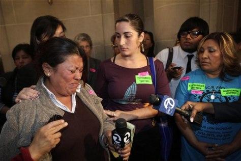 Image: Estela Muniz, left, cries as she stands next to activists Ariana Gil-Nafarrete, center, and Guillermina Castellanos