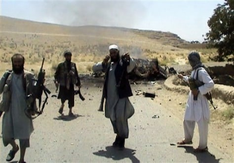 Image: Afghans holding weapons