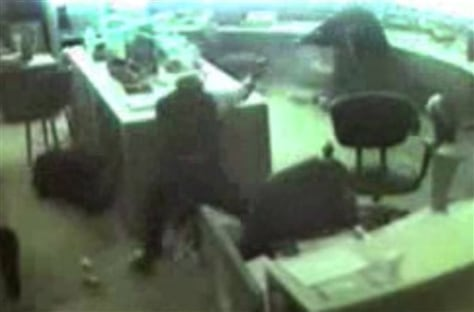 Image: Detroit precinct video shows Cmdr. Brian Davis shooting at Lamar Moore