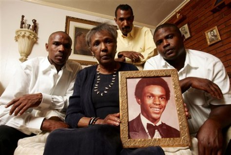 Image: Ruby Session holds a photo of her son Tim Cole, who died in prison