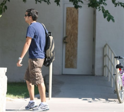 Image: Student walks past boarded up door