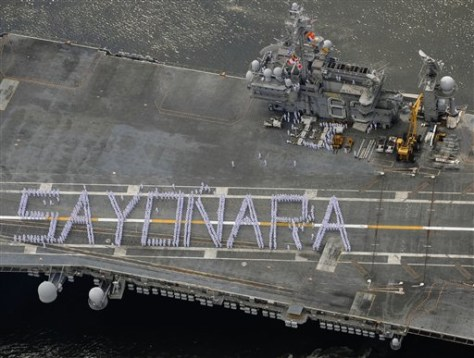 IMAGE: KITTY HAWK CREW SPELL OUT SAYONARA
