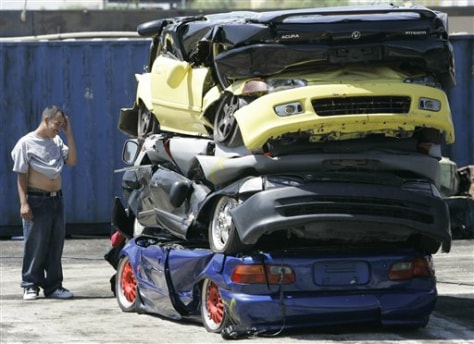 IMAGE: Manuel Hernandez and crushed cars