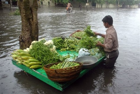 IMAGE: PRODUCE VENDOR IN FLOODED AREA