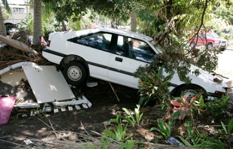 Image: Car wedged between trees