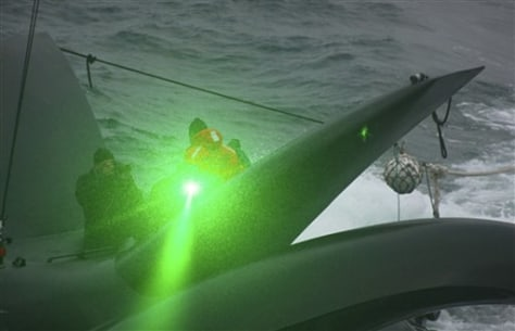 Image: Activist fires green laser at whalers