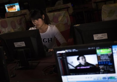 Image: Chinerse girl at Internet cafe