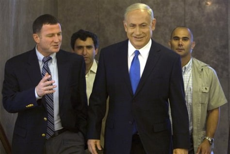 Image: Israeli Prime Minister Benjamin Netanyahu, front right, arrives at the weekly cabinet meeting