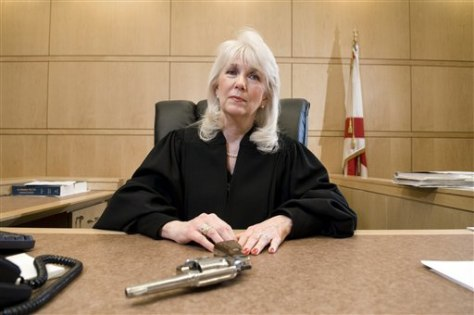 Image: Judge with gun in courtroom