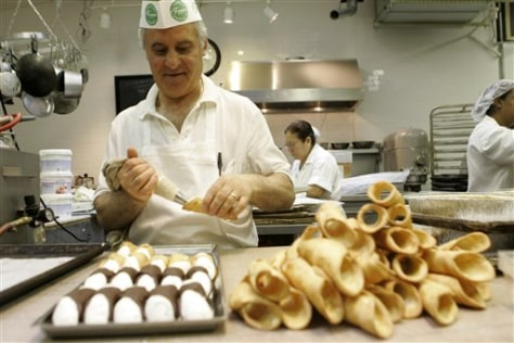 Image: Chef Fanco Amati stuffs cannoli shells