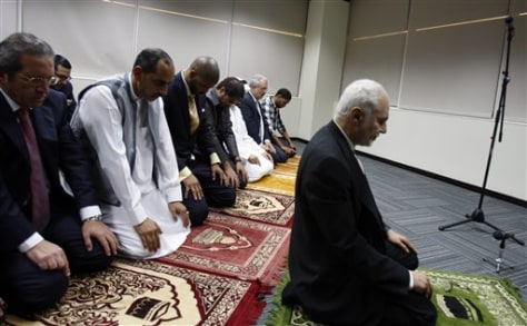 Image: Imam Feisal Abdul Rauf, right, leads the prayers during an Iftar ceremony