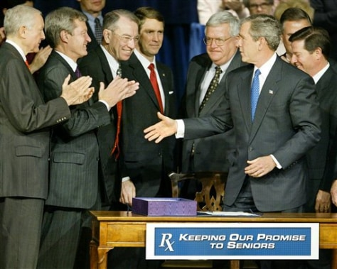 Image: President George W. Bush greets applauding Congressional leaders