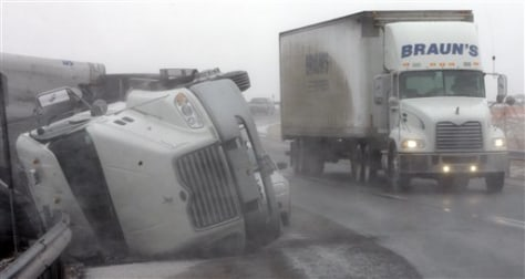 IMAGE: TRACTOR TRAILER BLOWN OVER BY WIND