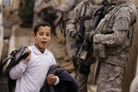 Image: Boy and U.S. troops