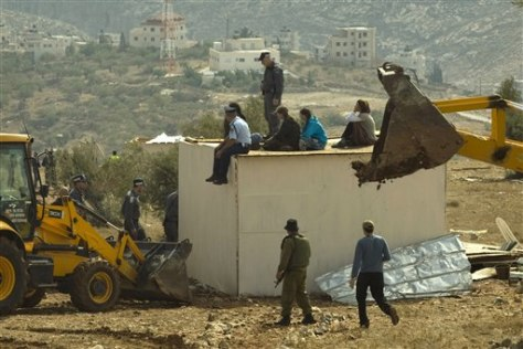Image: Israeli police demolish illegal settlers' structure