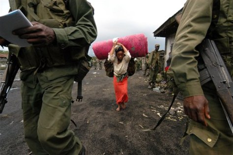 Image: Woman carries mattress in Congo