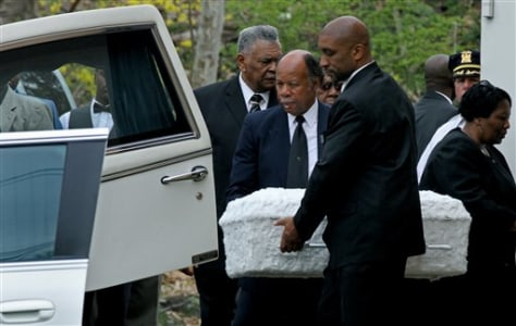 Image: Child's casket is placed in a hearse