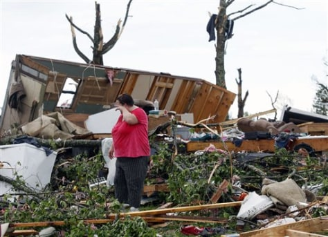 Image: Stephanie Cooper helps clean up tornado damage.