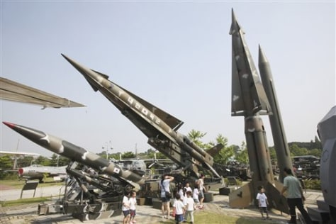 Image: South Korean kindergartners play near displays
