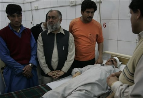 Image: Family members with injured man