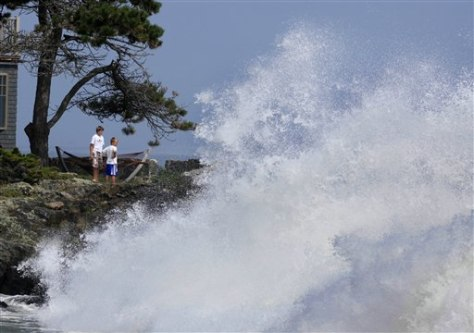 Image: Boys watch heavy surf