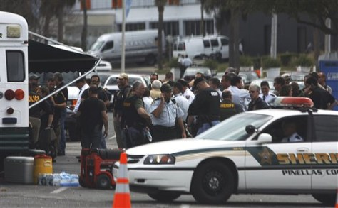 Image: Police search for a suspect in the shooting death of St. Petersburg, Fla., officer David Crawford