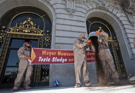 Image: Potesters pour compost on steps of City Hall in San Francisco.