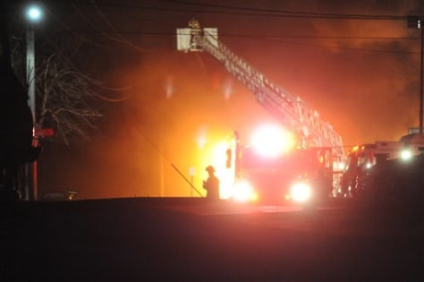 Image: A fire burns at the former Westclox factory