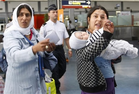 Image: Roma women gesture before being expelled