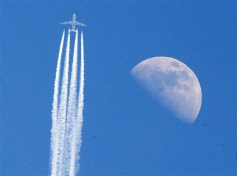 Image: Plane over Germany flies past the moon