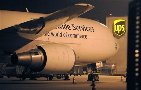 Image: A cargo plane parks at the UPS distribution center