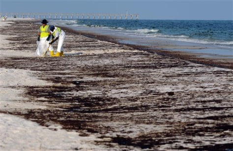 Image: Crew work to clean up spilled oil