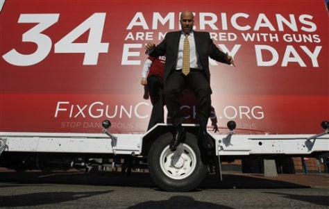 Image: Truck with billboard on gun background checks