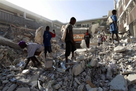 Image: Youths search the rubble