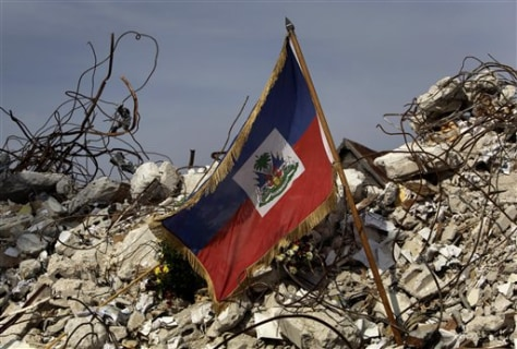 Image: Haitian flag sits on rubble