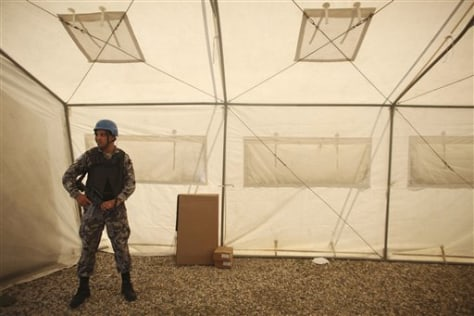 Image: A U.N. peacekeeper from Jordan guards electoral material in Haiti