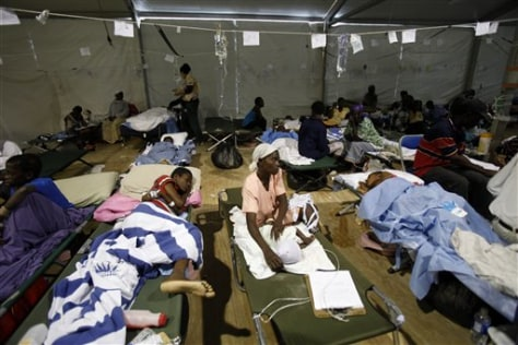 Image: Haitians at field hospital at airport