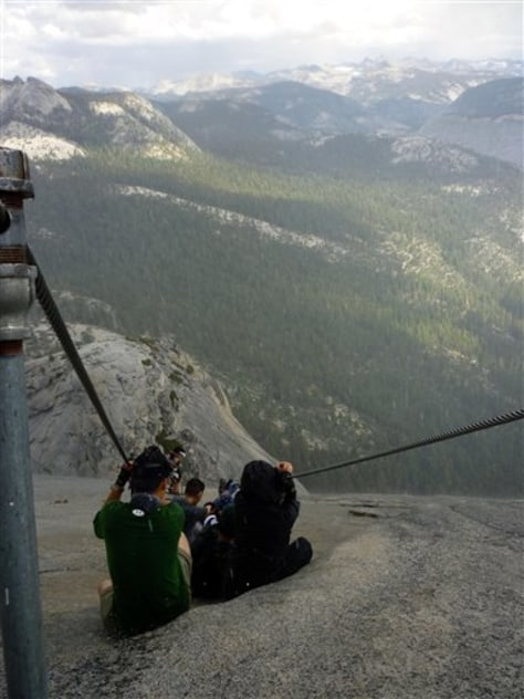 Image: hikers descend Half Dome in Yosemite, National Park