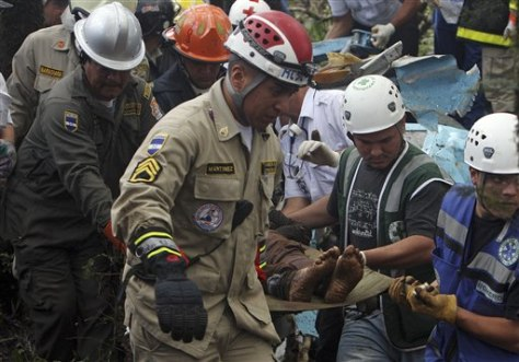 Image: Rescue workers remove bodies from plane-crash wreckage Monday on the outskirts of Tegucigalpa, Honduras.