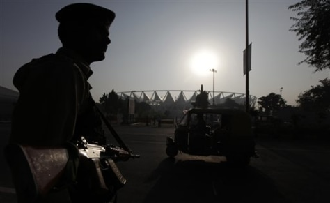 Image: A security guard stands guard outside the Jawaharlal Nehru stadium