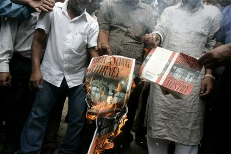 Image: Activists of the Bharatiya Vidyarthi Sena and the Shiv Sena, a Mumbai-centered political party known for regional chauvinism and Hindu fundamentalism, burn copies of a book