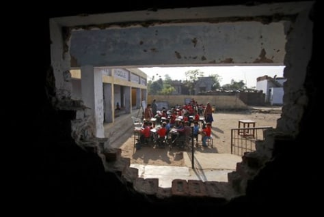 Image: Indian school children at a government school in the outskirts of Jammu, India.