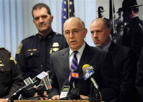 Image: Marion County Prosecutor Terry Curry speaks Thursday during a news conference regarding the murder of Indianapolis Metropolitan Police Department Officer David Moore.